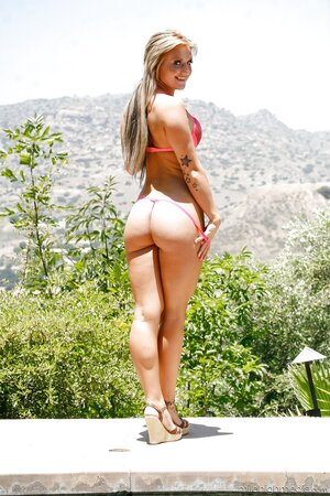 Lovely model likes to be naked on camera in front of beautiful nature