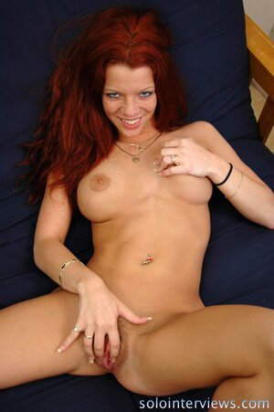 Redhead with enhanced tits takes glass dildo to bring herself to orgasm