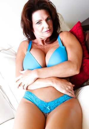 Grown-up goddess poses in blue lingerie that accentuates her fabulous assets