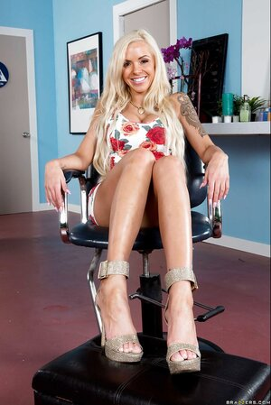 Tempting blonde adult star flirts on camera abiding clients in the undressed