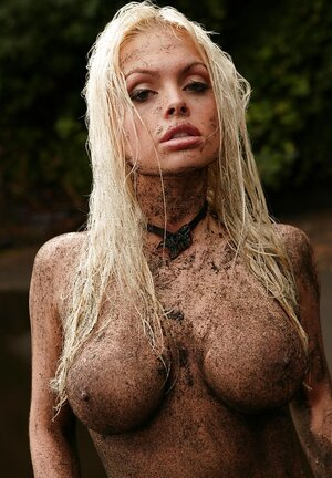 Bigtitted blonde's swanky body is covered with sand additionally and additionally she moves to water