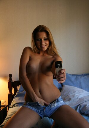 Tanned girl turns on taking digital stills of her nude tits and takes a toy to jack off