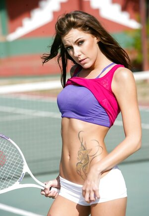 Broad with tattoo on tummy plays tennis and plus finds a long time to show undersized ass