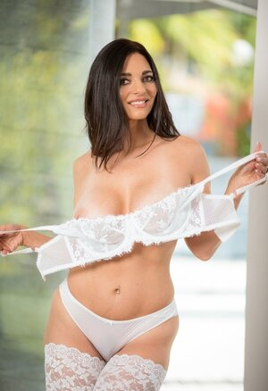 Brunette Sexually available mom with seductive tan lines wears nothing but white stockings