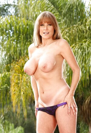 Floozy unmasks big knockers and plus tight muff at the XXX pool photoshoot