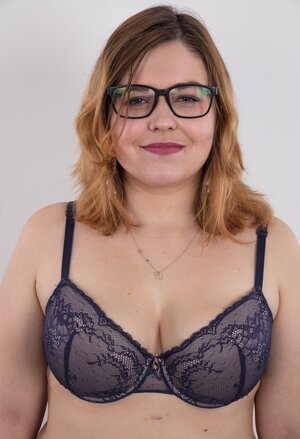 Porky whore with glasses rocks out in the pornography studio trying striptease skills out