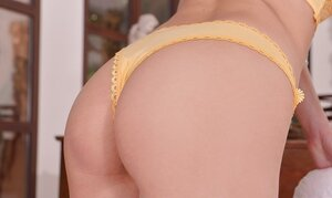 Czech floozy Niki Diamond in yellow underwear and plus black high heels gets naked
