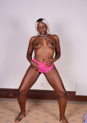 Platinum blonde dame with black skin shows how her cum bucket looks like